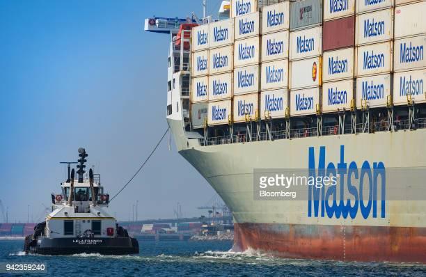 A tugboat guides the Matson Inc Mokihana cargo ship into the Port of Long Beach in Long Beach California US on Wednesday April 4 2018 The US trade...