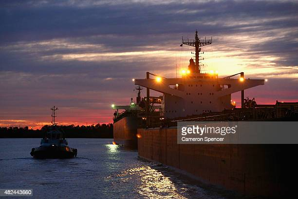 Tugboat Master John Duncan and other tugboats assist the 'Oriental Treasure' bulk carrier ship from Kooragang Island Coal Terminal through Newcastle...