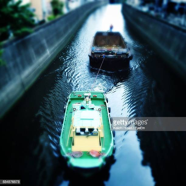 Tugboat Pulling Barge In Canal