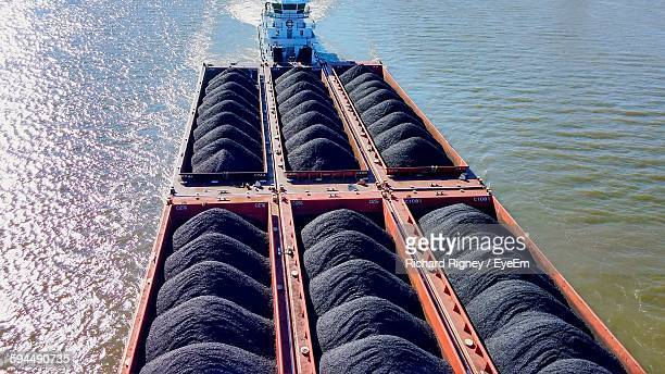 tugboat pulling barge with coal on ohio river - barge stock photos and pictures