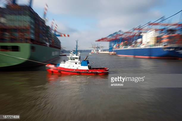 Tugboat Pulling Ship in Port of Hamburg