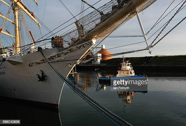A tugboat sails past the Polish ship Dar Mlodziezy during the North Sea Tall Ships Regatta on August 27 2016 in Blyth England The bustling port town...