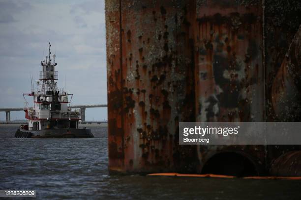 Tugboat sits anchored near a decommissioned oil platform ahead of Hurricane Laura in Sabine Pass, Texas, U.S., on Tuesday, Aug. 25, 2020. Hurricane...