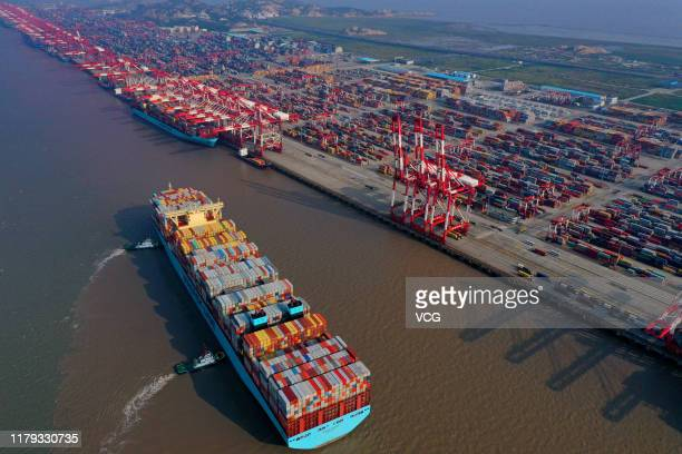 Tugboats guide a container ship of Maersk Line at the Yangshan Deepwater Port operated by Shanghai International Port Co Ltd on October 4 2019 in...