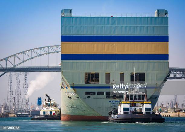 Tugboats guide the Matson Inc Mokihana cargo ship into the Port of Long Beach in Long Beach California US on Wednesday April 4 2018 The US trade...