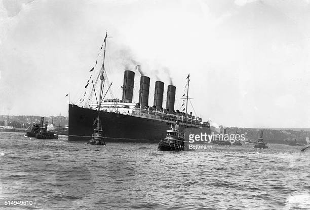 Tugboats guide the ocean liner the SS Lusitania whose sinking by a German submarine on its New YorkLiverpool route was a contributing factor to the...