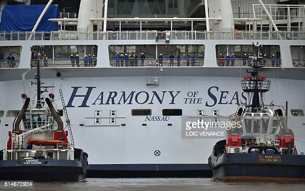 Tugboats lead the Harmony of the Seas cruise to leave the STX shipyard of SaintNazaire western France for a threeday test offshore on March 10 2016...