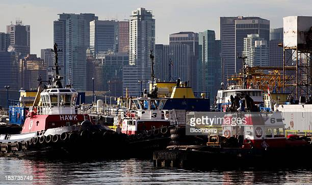 Tugboats sit docked at the Seaspan Vancouver Shipyard in North Vancouver British Columbia Canada on Wednesday Oct 9 2013 Canadian Public Works...