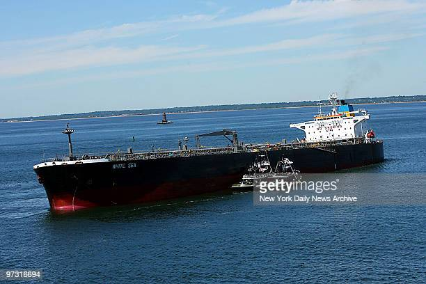 Tugboats straddle the oil tanker White Sea as it sits grounded off Coney Island The tanker carrying more than 19 million gallons of fuel oil ran...