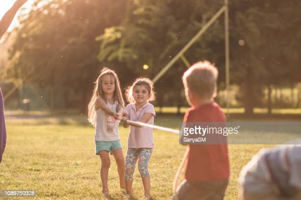 tug-of-war - hot teacher stock pictures, royalty-free photos & images