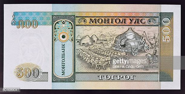 Tugrik banknote, 1990-1999, reverse, Genghis Khan's yurt pulled by oxen. Mongolia, 20th century.