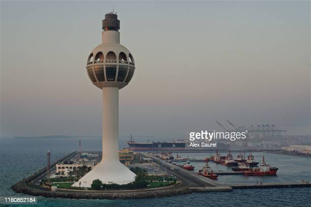 tugs and freighter boat docked next to the lighthouse, jeddah harbor, saudi arabia - jiddah stock pictures, royalty-free photos & images