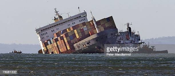Tugs and rescue boats are moored next to the stricken ship MSC Napoli on January 23 2007 in Branscombe England Police and coast guard officials have...