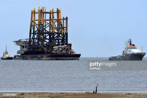 Tugs towing another module from an Oil Rig into the Able Uk yard at Greatham Hartlepool England on October 1 2020 for decommissioning The town has...