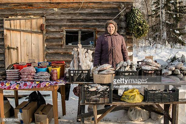 Tuhtabiya poses for a picture near her shack near the Siberian village of Yangutum on January 22 2016 in Siberia Russia Local people live in this...