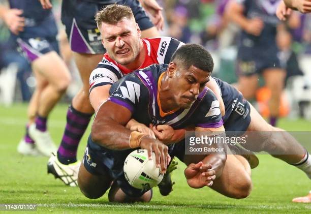 Tui Kamikamica of the Melbourne Storm scores a try during the round 6 NRL match between the Melbourne Storm and the Sydney Roosters at AAMI Park on...