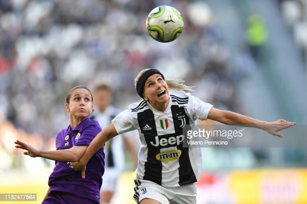 Tuija Hyyrynen of Juventus FC Women in action against Tatiana Bonetti of Fiorentina Women's FC during the Women Serie A match between Juventus Women...