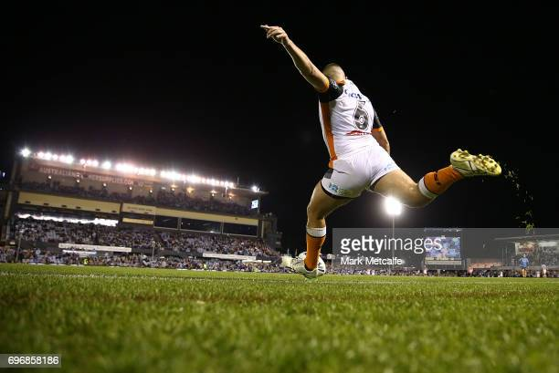 Tuimoala Lolohea of the Tigers kicks a conversion during the round 15 NRL match between the Cronulla Sharks and the Wests Tigers at Southern Cross...