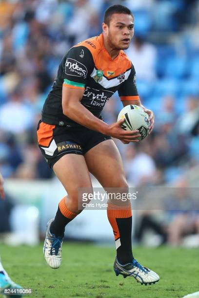 Tuimoala Lolohea of the Tigers runs the ball during the round 21 NRL match between the Gold Coast Titans and the Wests Tigers at Cbus Super Stadium...