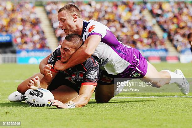 Tuimoala Lolohea of the Warriors dives over to score a try during the round three NRL match between the New Zealand Warriors and the Melbourne Storm...