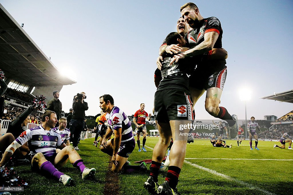 Tuimoala Lolohea of the Warriors is congratulated by teammates Sam Tomkins and Bodene Thompson after scoring a try during the round 18 NRL match between the New Zealand Warriors and the Melbourne Storm at Mt Smart Stadium on July 12, 2015 in Auckland, New Zealand.