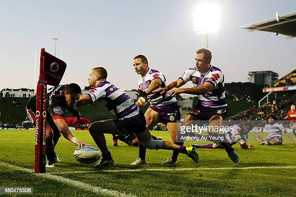 Tuimoala Lolohea of the Warriors scores a try in the corner during the round 18 NRL match between the New Zealand Warriors and the Melbourne Storm at...