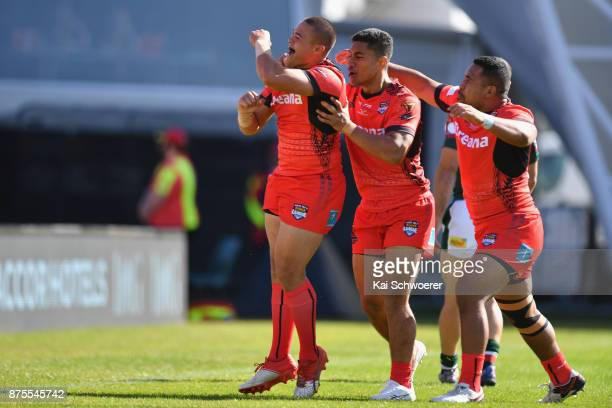 Tuimoala Lolohea of Tonga celebrates with team mates after scoring a try during the 2017 Rugby League World Cup Quarter Final match between Tonga and...