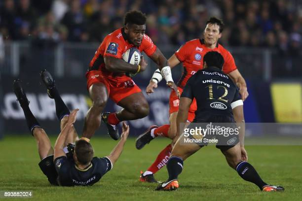 Tuisova Josua of Toulon leaps over the challenge of Rhys Priestland of Bath as Ben Tapuai closes in during the European Rugby Champions Cup match...