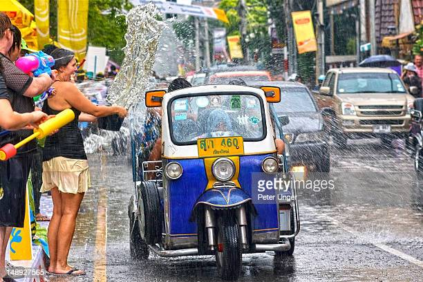 Tuk Tuk being doused with water at Songkran Festival.