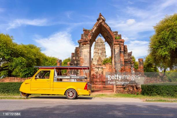 tuk tuk car tourist at parking outdoors with wat mahathat background - taxiway stock pictures, royalty-free photos & images