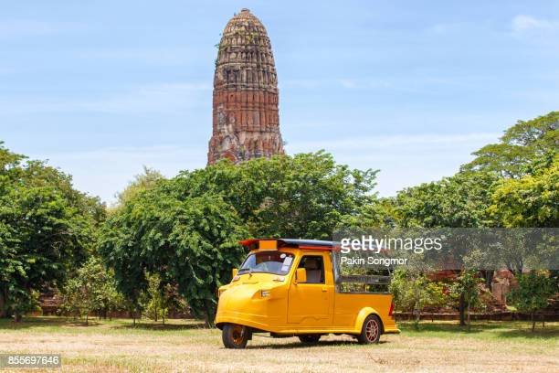 Tuk Tuk car tourist at parking outdoors with Wat Mahathat background