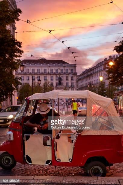 Tuk tuk driver, Lisbon, Portugal
