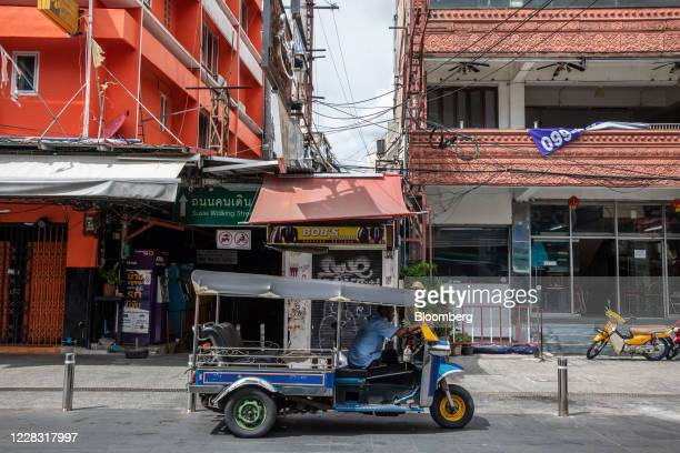 A tuk tuk driver waits for a customer at a nearempty Khao San Road in Bangkok Thailand on Wednesday Sept 2 2020 Thailand has reported zero...