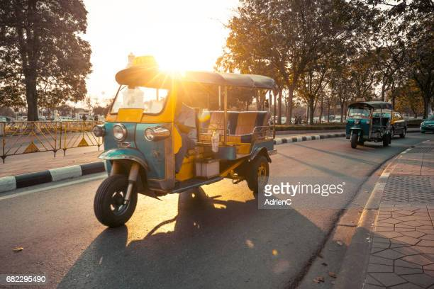 a tuk tuk in bangkok city during sunset- thailand - auto rickshaw stock pictures, royalty-free photos & images