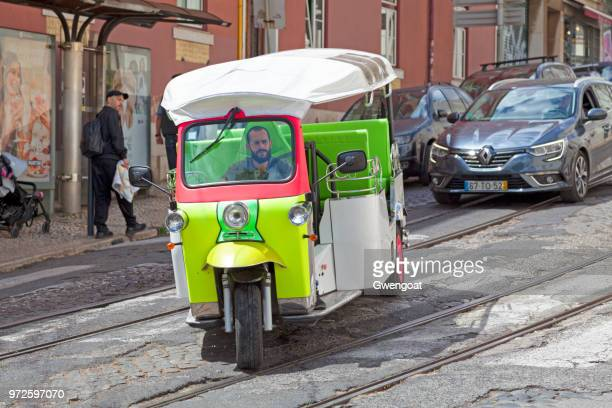 tuk tuk in old town of lisbon - gwengoat stock pictures, royalty-free photos & images