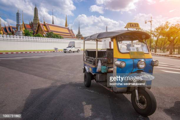 tuk tuk is parking in front of wat phra kaeo or grand palace, bangkok, thailand. - auto rickshaw stock pictures, royalty-free photos & images