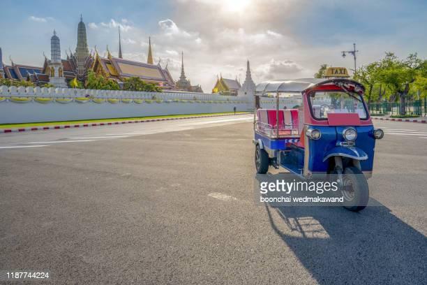 tuk tuk is parking in front of wat phra kaeo or grand palace, bangkok, thailand. - rickshaw stock pictures, royalty-free photos & images