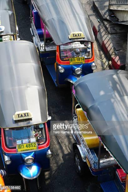 Tuk Tuk, local motorbike taxi waiting for customers in local market in Bangkok