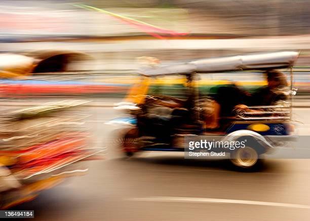 Tuk Tuk motorized rickshaw speeding in Bangkok