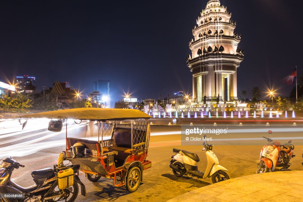 Tuk Tuk parked in front of the Independance monument, in Phnom Penh, Cambodia : Stock Photo