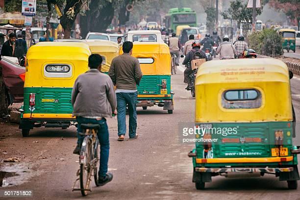 Tuk Tuks on a busy street in Old Delhi, India