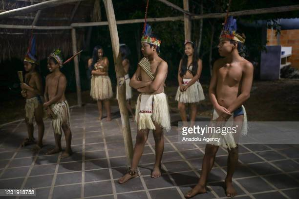 Tukano Indigenous People are seen at the maloca at the Panure indigenous reservation in San Jose del Guaviare, Colombia on March 24, 2021....