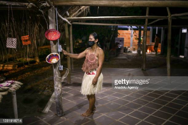 Tukano Oriental Indigenous woman at the maloca at the Panure indigenous reservation in San Jose del Guaviare, Colombia on March 24, 2021. Originating...