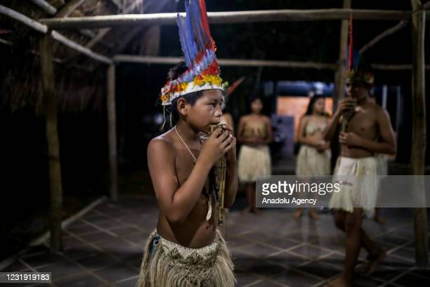 Tukano Oriental man Indigenous during a traditional dance at the maloca at the Panure indigenous reservation in San Jose del Guaviare, Colombia on...