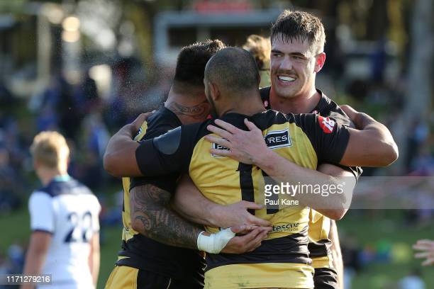 Tukiterangi Raimona Jonah Placid and Fergus LeeWarner of the Force celebrate winning the round one NRC match between the Western Force and Queensland...