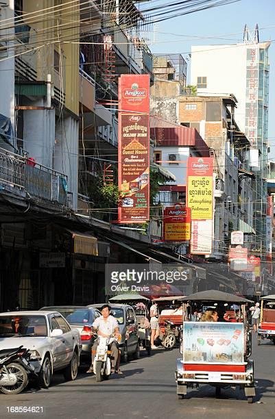 CONTENT] TukTuk and scooter traffic on Street 172 with its backpacker hostels budget hotels restaurants and bars a popular tourist district in the...