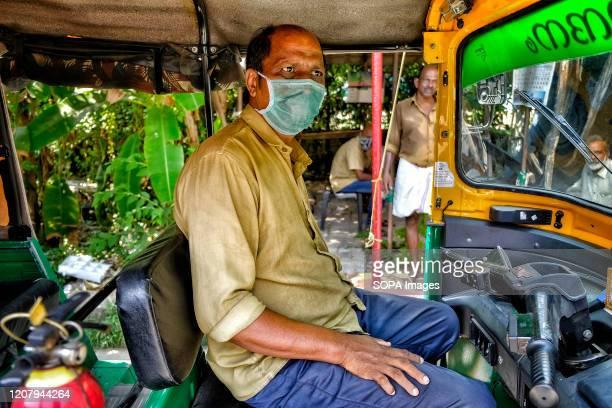 Tuk-tuk driver wears a face mask as a precaution against the spread of Coronavirus in Kochi. With 298 confirmed coronavirus cases, India has already...