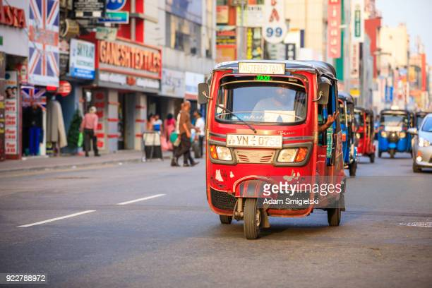 tuktuk taxi on the streets of colombo; sri lanka - auto rickshaw stock pictures, royalty-free photos & images
