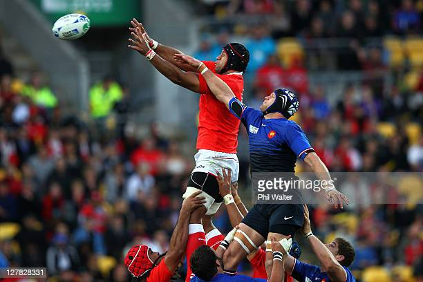 Tukulua Lokotui of Tonga wins lineout ball under pressure from Julien Bonnaire of France during the IRB 2011 Rugby World Cup Pool A match between...
