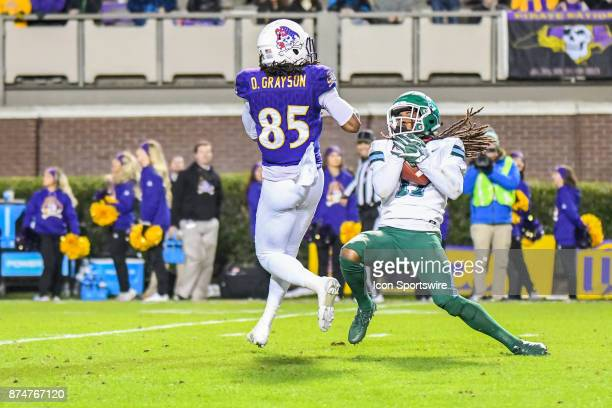 Tulane Green Wave cornerback Parry Nickerson reaches up to catch the interception as East Carolina Pirates wide receiver Davon Grayson looks to...